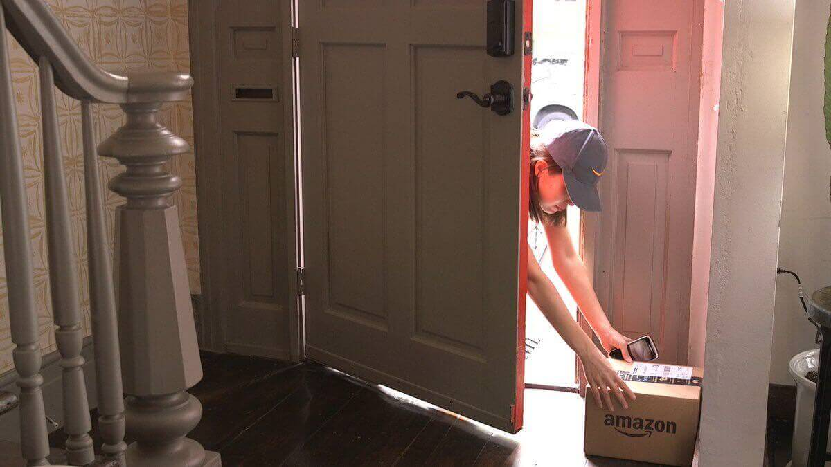 Amazon service will let couriers open front doors